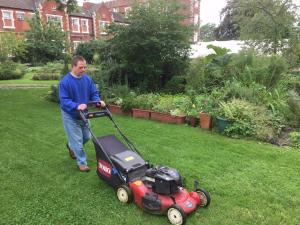 John mowing at the Share Garden