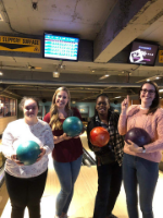 Volunteers and students going bowling