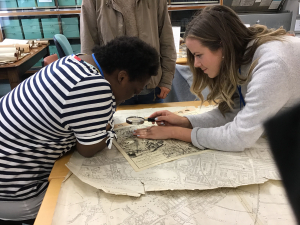 Students looking at historical documents