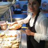 Fatima serving food in the on site cafe