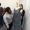 Gifty dressing the mannequin