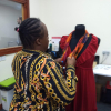 Makedah dressing the mannequin