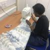 Doris sewing her bag