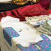 a range of bags and t-shirts made by students