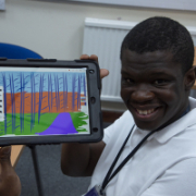 Shaun showing his digital artwork on the ipad